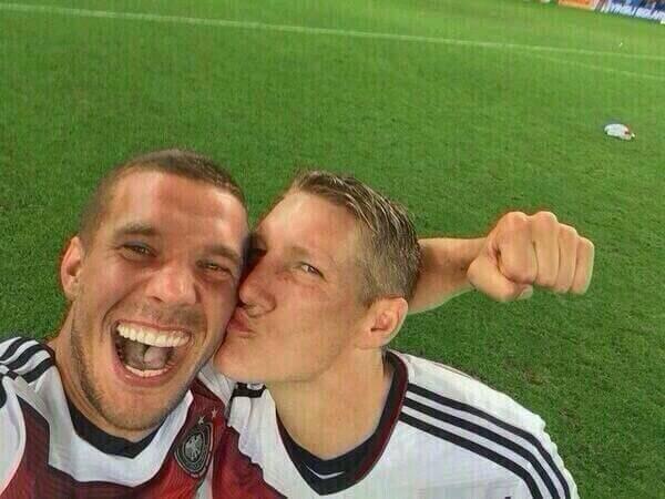 Podolski with Schweinsteiger