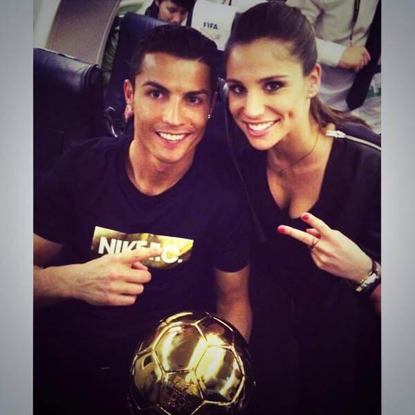 Ronaldo with Lucia Villalon and Ballon D'or trophy